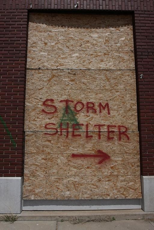 48. Storm shelter sign on damaged bank building, Greensburg,