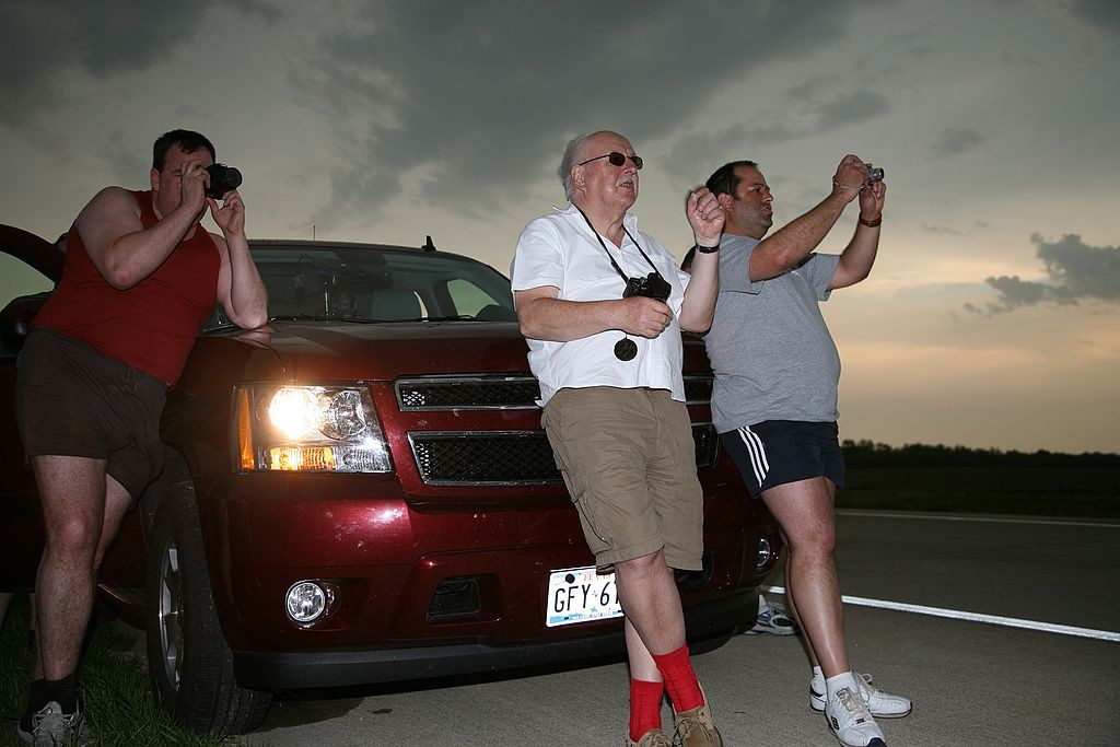 50. Stuart, Michael Fish and Ian P watching the storm, near