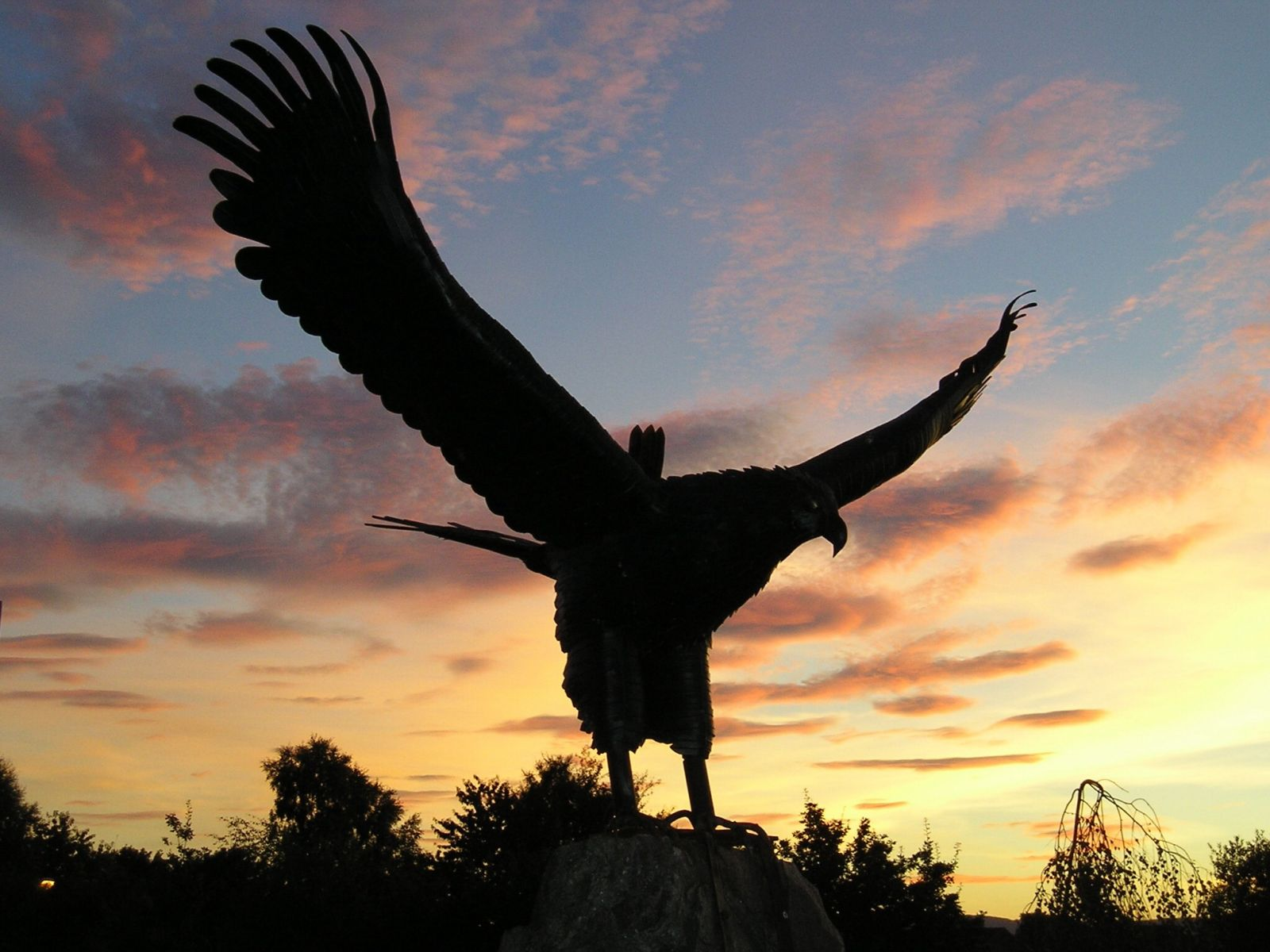 Eagle statue silhouetted against the sunrise